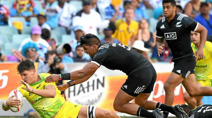 Dylan Pietsch of Australia (left) is tackled by Dylan Collier of New Zealand at the Sydney Sevens.