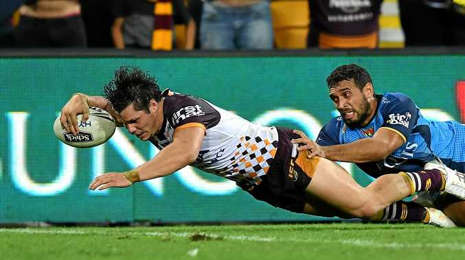 James Roberts of the Brisbane Broncos scores the winning try against the Titans.