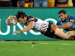 Roberts bags hat-trick as Broncos see off plucky Titans