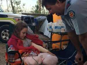 Girl wakes to 2.5m snake coiled on arm while camping