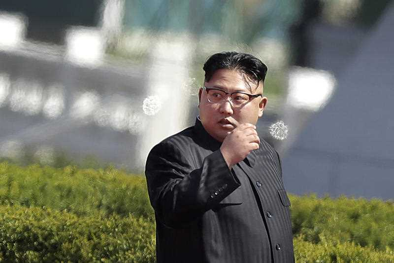 North Korean leader Kim Jong Un arrives for the official opening of the Ryomyong residential area, on Thursday, April 13, 2017, in Pyongyang, North Korea. Japan's Prime Minister Shinzo Abe, speaking Thursday at a parliamentary panel on national security and diplomacy, warned that North Korea may be capable of firing a missile loaded with sarin nerve gas toward Japan.