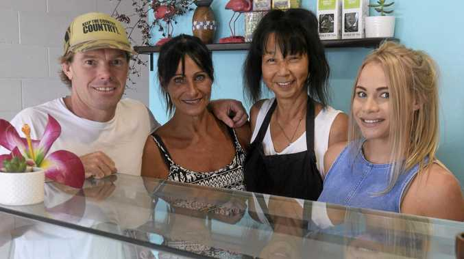 FAMILY BUSINESS: Aloha Sushi owners Chris Hellmrich and Toni Sharpe with Koki and Emily Hardman, two weeks after the business opening.
