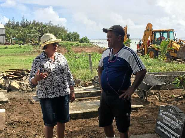 Cate Walker discussing the history of the Nikao cemetery with Tupapa-Maraerenga MP George Maggie.