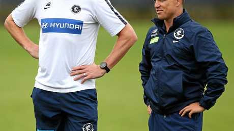 Assitant coach John Barker and head coach Brendon Bolton look on during a Carlton training session at Ikon Park