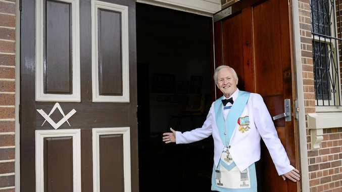 COME ON IN: The Ipswich Masonic Lodge member Cliff Houston welcomes new members through their doors.