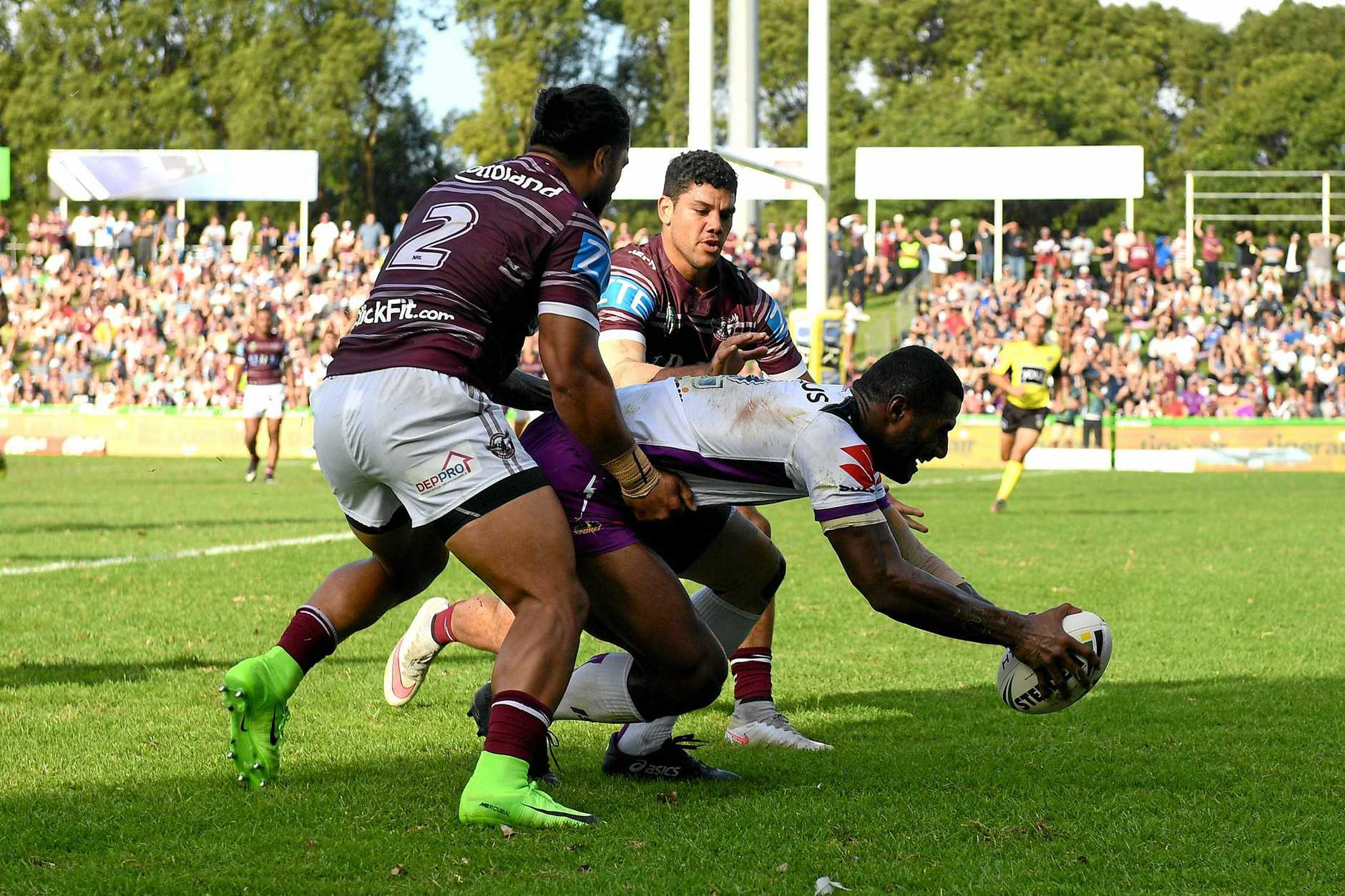 Suliasi Vunivalu of the Storm scores a try against Manly.