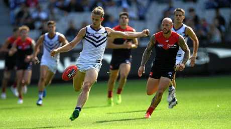 Nat Fyfe of the Dockers (left) gets away from Nathan Jones of the Demons.