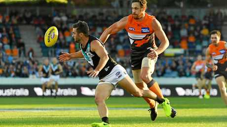 Sam Gray of the Power gets the ball ahead of Shane Mumford of the Giants.