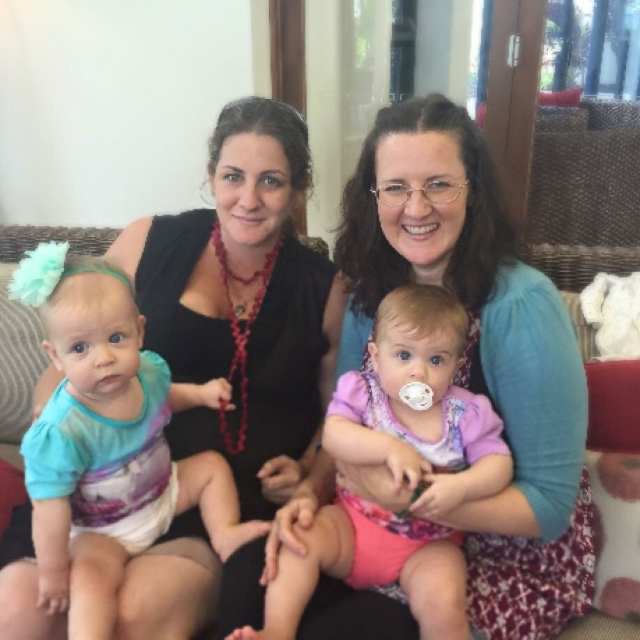 Melisa (left) with Nicola (right) and her twins Rory and Callie born via Melissa's egg donation