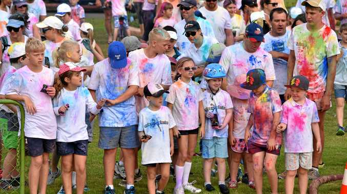 COLOURFUL FUN: Competitors begin the 5km ColourXplosion fun run at Bassett Park.