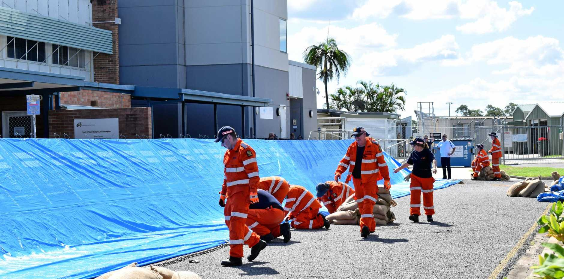 Rockhampton Airport was closed during the flood, with this temporary flood barrier installed. It has now re-opened, but a free suttle service taking travellers to Gladstone flights will continue this week.