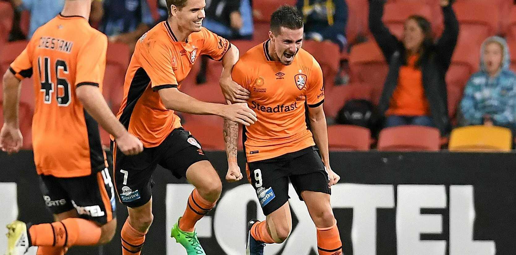 Jamie Maclaren (right) celebrates scoring a goal against the Phoenix.