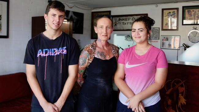 Rosewood body-piercing specialist Cathy (centre).