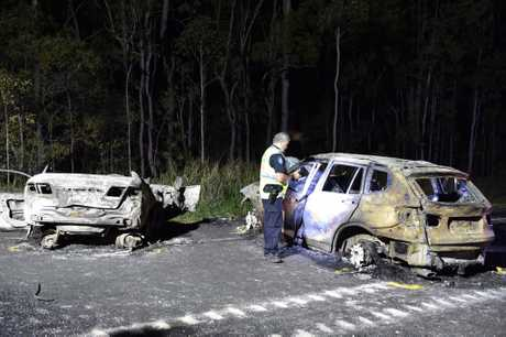 Crash investigators at the scene of a double fatality on the Bruce Highway two kilometres north of Tiaro.