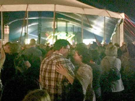 A visiting couple enjoys a romantic moment during Santana's show at Bluesfest 2017.