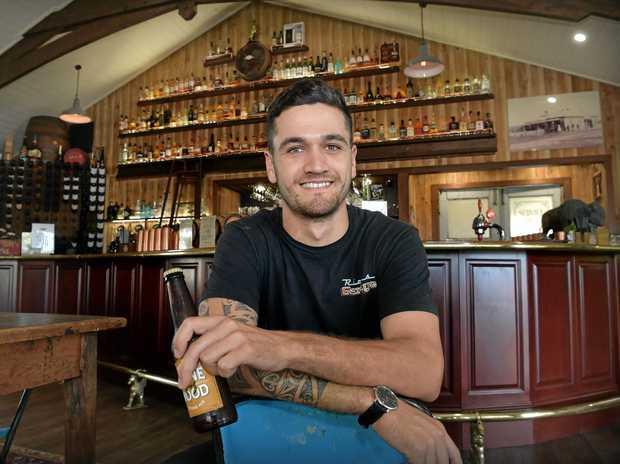 BOOMING: Rick's Garage operations manager Tama Jamieson at Rick's Garage upstairs whiskey bar.