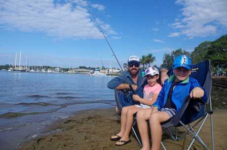 Fishing on Cabbage Tree Creek ahead of the Brisbane to Gladstone Yacht Race is Will Scherf and his children Lebraya and Frazer of Sandgate.