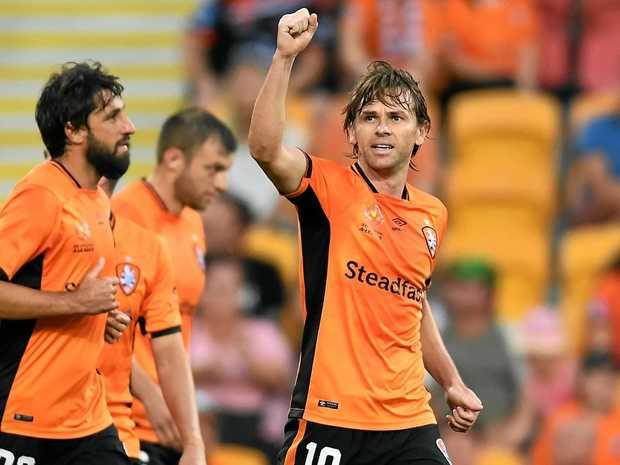 ROAR GOAL: Brett Holman celebrates during Brisbane's come-from-behind win over Wellington Phoenix.