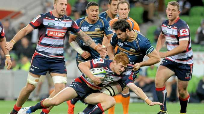 AGGRESSION: Rebels captain Nic Stirzaker takes the ball to the ground in Melbourne's win over the Brumbies.