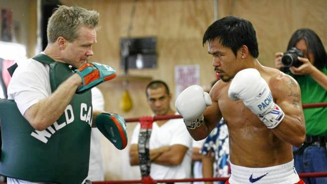 Manny Pacquiao works out with trainer Freddie Roach.