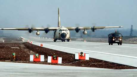 A C-130 Hercules aircraft taxing on a German motorway.