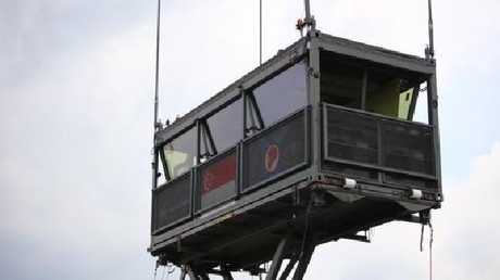 A mobile air traffic control tower in Singapore wheeled in on a truck.