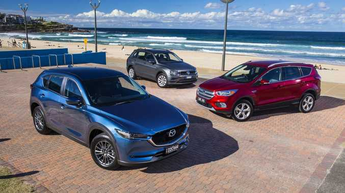 BATTLEGROUND: Put to the mid-size SUV test are the Mazda CX-5, VW Tiguan and Ford Escape
