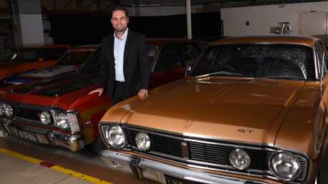 Lee Hames with some of the Classic cars that will be Auctioned at Lloyds on April the 22nd.