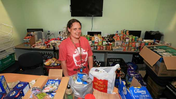 HERE TO HELP: Murwillumbah Community Centre's services coordinator Amanda Lindh with just some of large amount of food donations they have received.