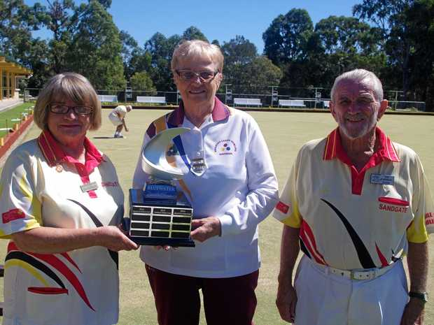 Holding the Bluewater Bowls Classic perpetual trophy are Angela Baker and Marion Burford with Ted Fairman.