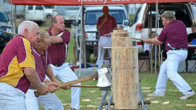 WOOD CHOP: Competitors begin to chop away in the second heat.