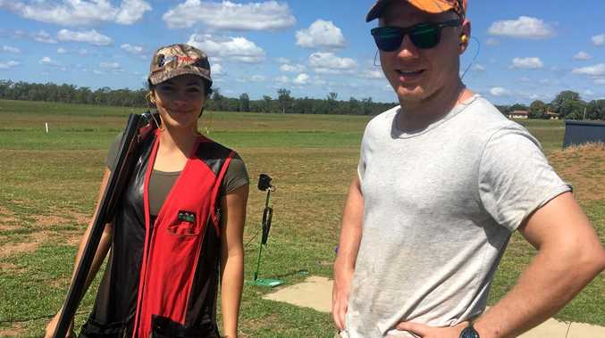 Brooke Geary and Trent Alkemade before the competition begins at the Central Burnett Gun Club.