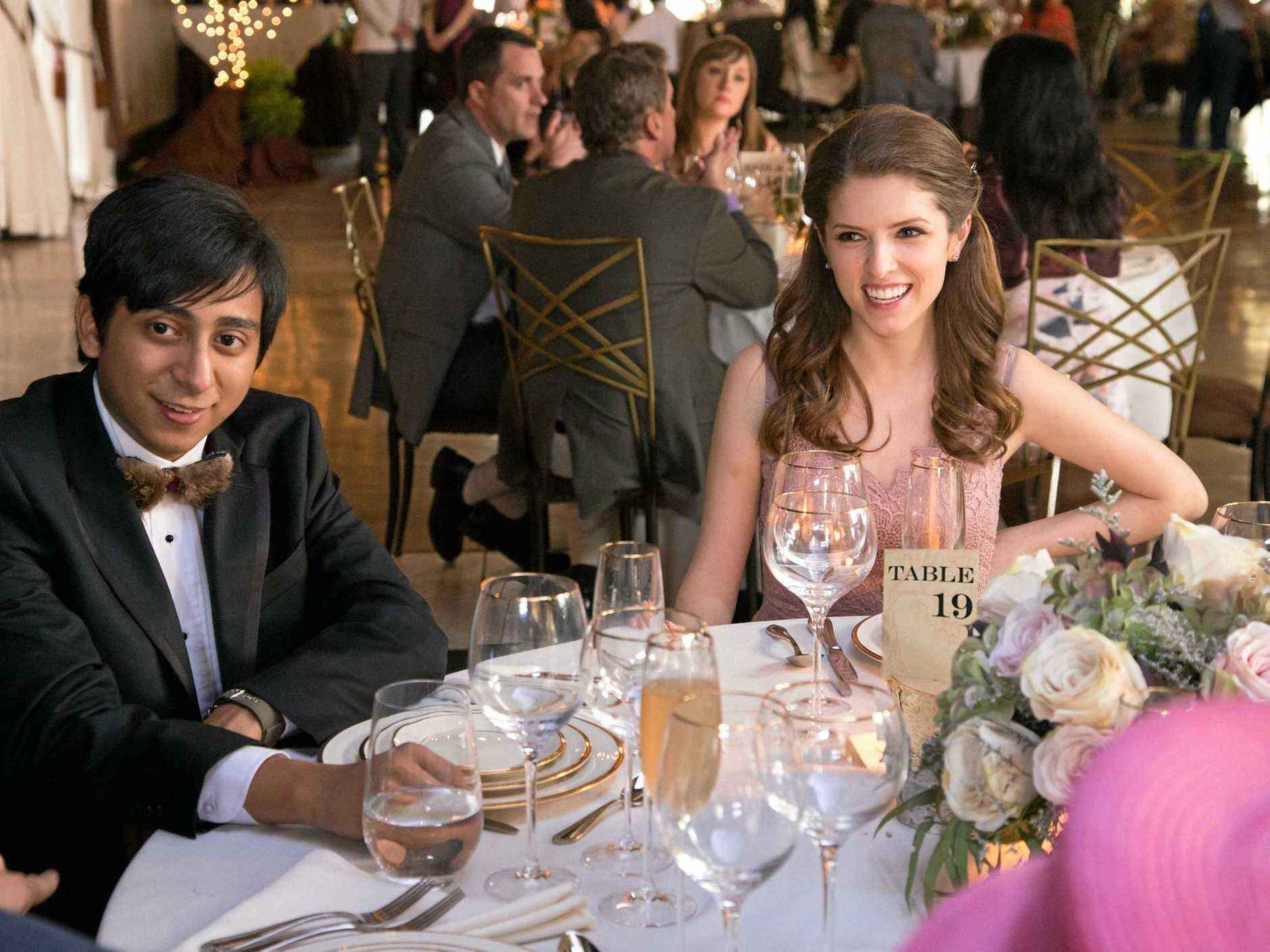 Tony Revolori and Anna Kendrick in a scene from the movie Table 19.