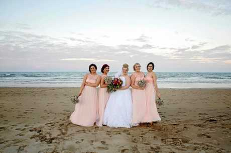 BRIDAL PARTY: The bride surrounded by her four bridesmaids who wore pastel pink on the big day.