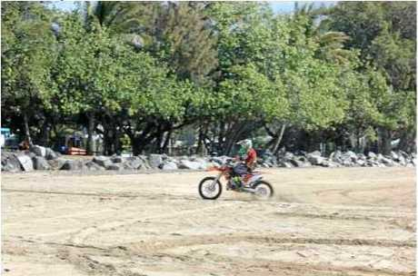 A motorbike rider on Shoal Point Beach.