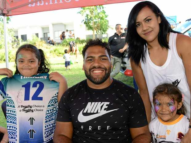 Family Fun Day and junior development rugby league clinic at Brooking Parklands, Ripley. Broncos player Sam Thaiday with Roe-Anna Walker, Mahleika-Conlon, 4, and Mayillah Walker, 2, of Ipswich.