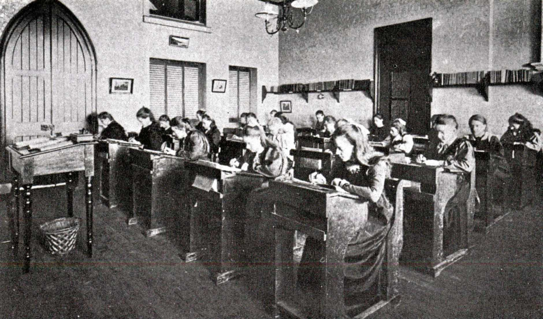 Classroom in the original school building circa 1900.
