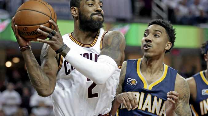 Cleveland's Kyrie Irving under pressure from Indiana's Jeff Teague.