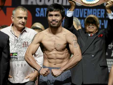 Worth the wait? Manny Pacquiao poses on the scale during a weigh-in last year.