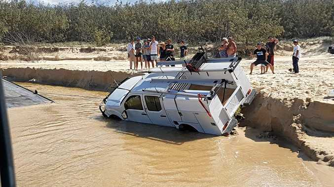 OFF THE ROAD: A family was travelling in a dual-cab ute when it came to grief on Fraser Island yesterday.