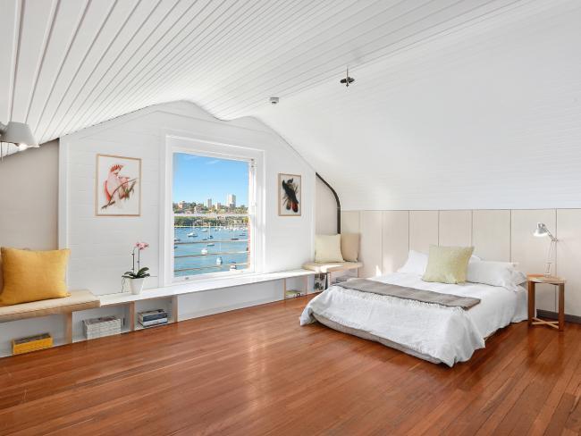 Elizabeth Bay unit has charming views to Sydney Heads.