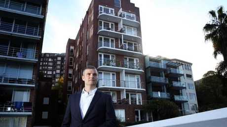 Real Estate agent Charlie Mortimer outside the apartment building in Elizabeth Bay, where a 50 sqm roof cavity apartment has sold for $1m.