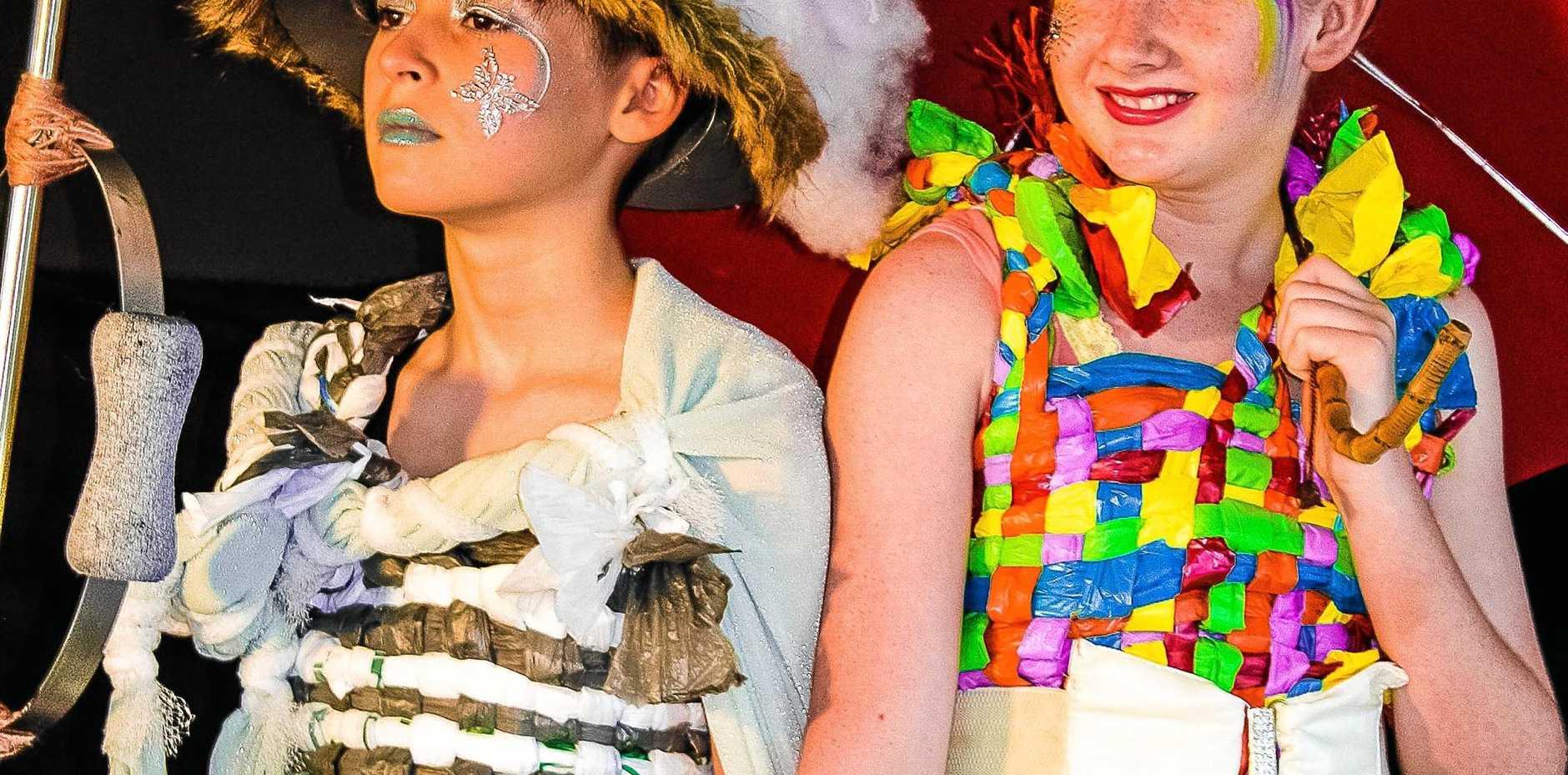 HEAD TURNERS: Cooran School year six students Isla (left) and Shayne (right) model wearable art at the Australian Body Art Festival.
