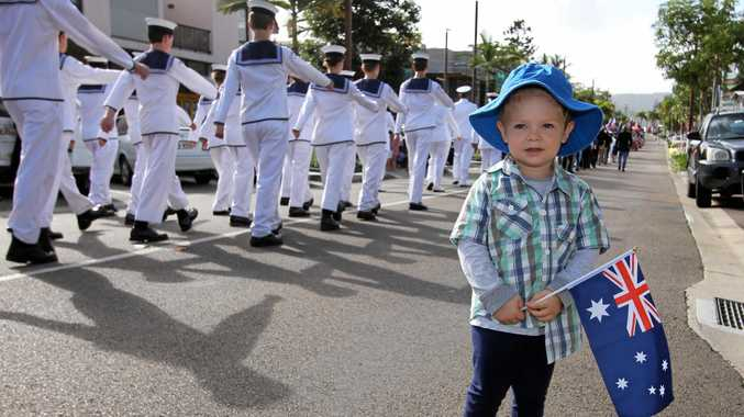 LITTLE ONLOOKER: Lleyton Smith waves to the Anzac Day march in Airlie Beach. Photo Sharon Smallwood / Whitsunday Times