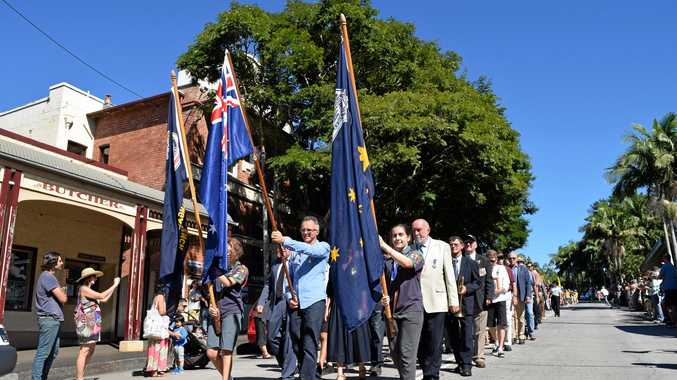 BANGALOW ON THE MARCH: The Anzac Day parade makes its way down Byron Street in Bangalow.