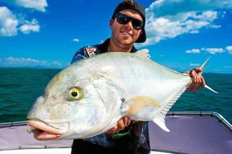 GREAT CATCH: Karl Burton with a stomper of a golden trevally caught while on charter with Reel Addiction Fishing Sportfishing.