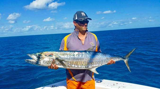 HOLY MACKEREL: Yudi Lloyd, from Melbourne, with a solid spanish mackerel caught at the reef on Sunday with Sea Fever.