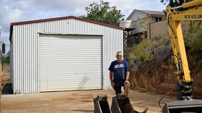 NOW OPEN: Paul Dare in front of the new Men's Shed which opened up in Mundubbera.