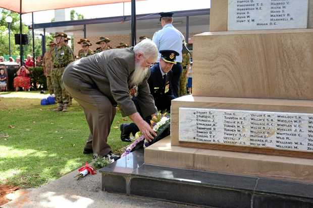 Chinchilla RSL Sub Branch president Bill Belcher and RAAF Group Captain Ross Bender lay a wreath.