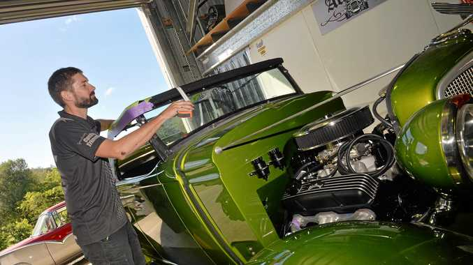 REVVED UP: President of the Mackay Rod and Custom Club Jeff Fussell works on getting Jill Sammut's '34 Chev ready for the Mackay Motor Show.